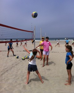 beach camp spiking coach toss
